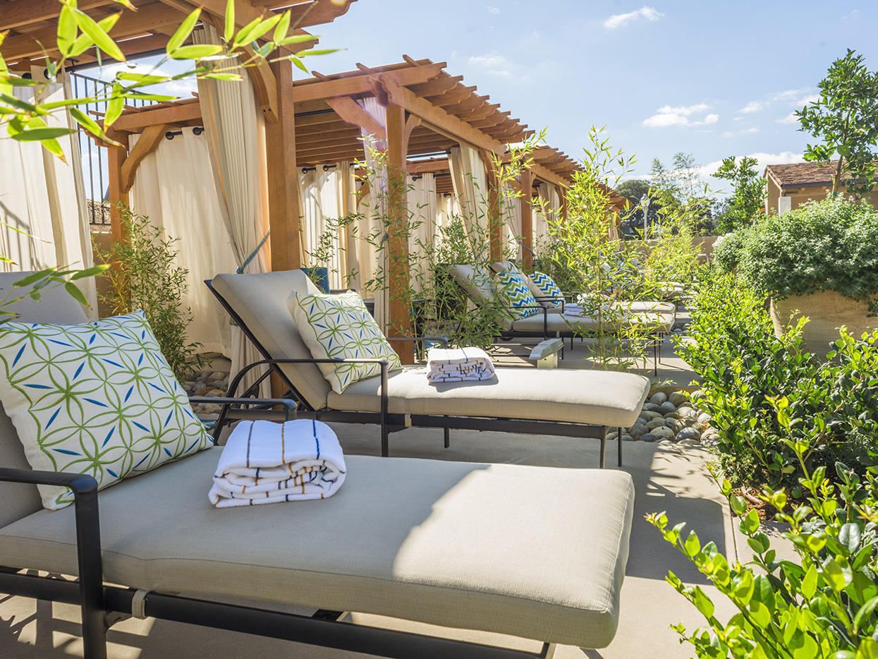 Cabanas and lounge chairs poolside