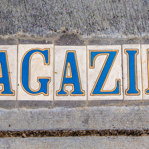 The word MAGAZINE written on a stone wall near the hotel