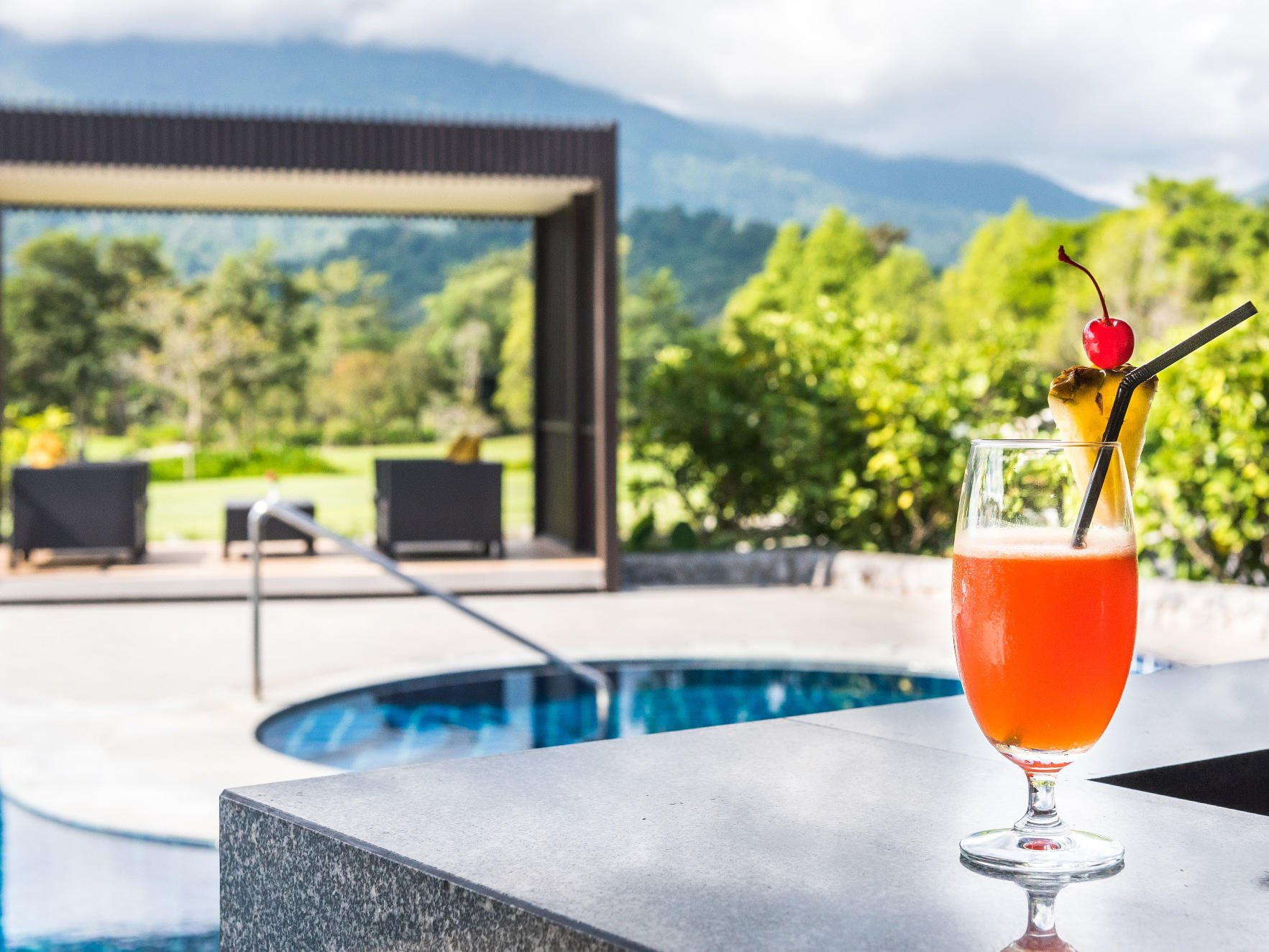 A cocktail near a pool in Chatrium Golf Resort at Soi Dao