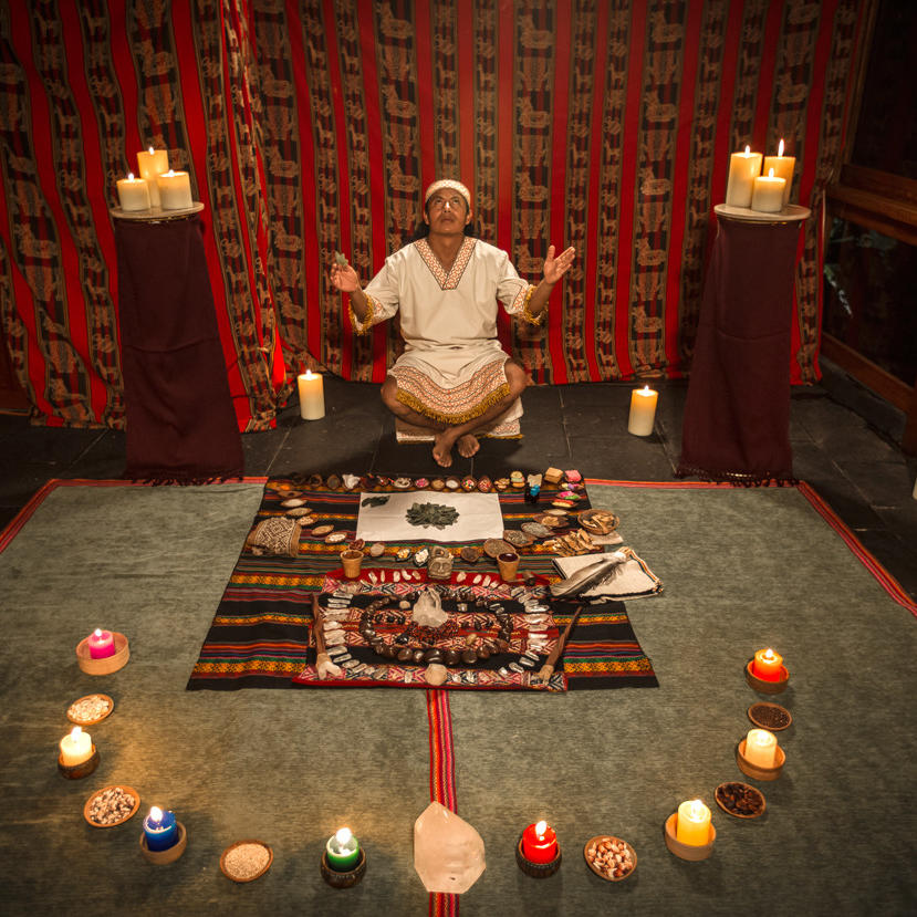 Priest performing Offering to pachamama rituals at Hotel Sumaq
