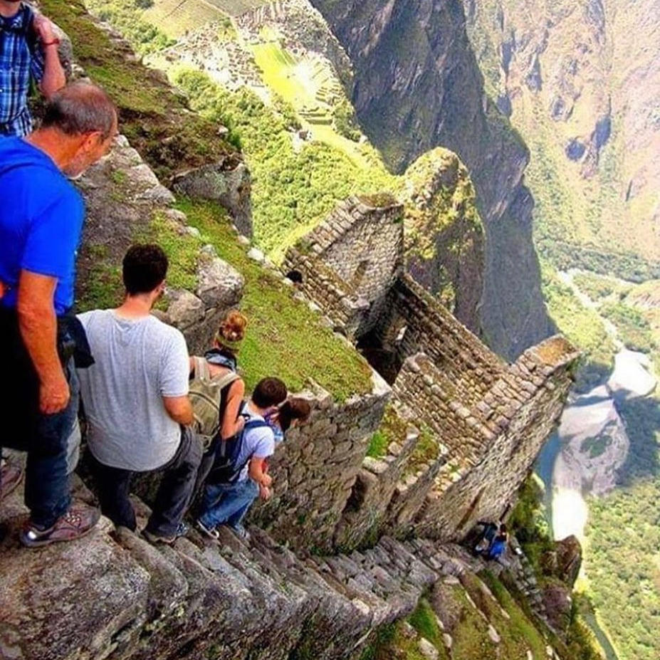 Group climbing down the stairs at The Temple of the Moon