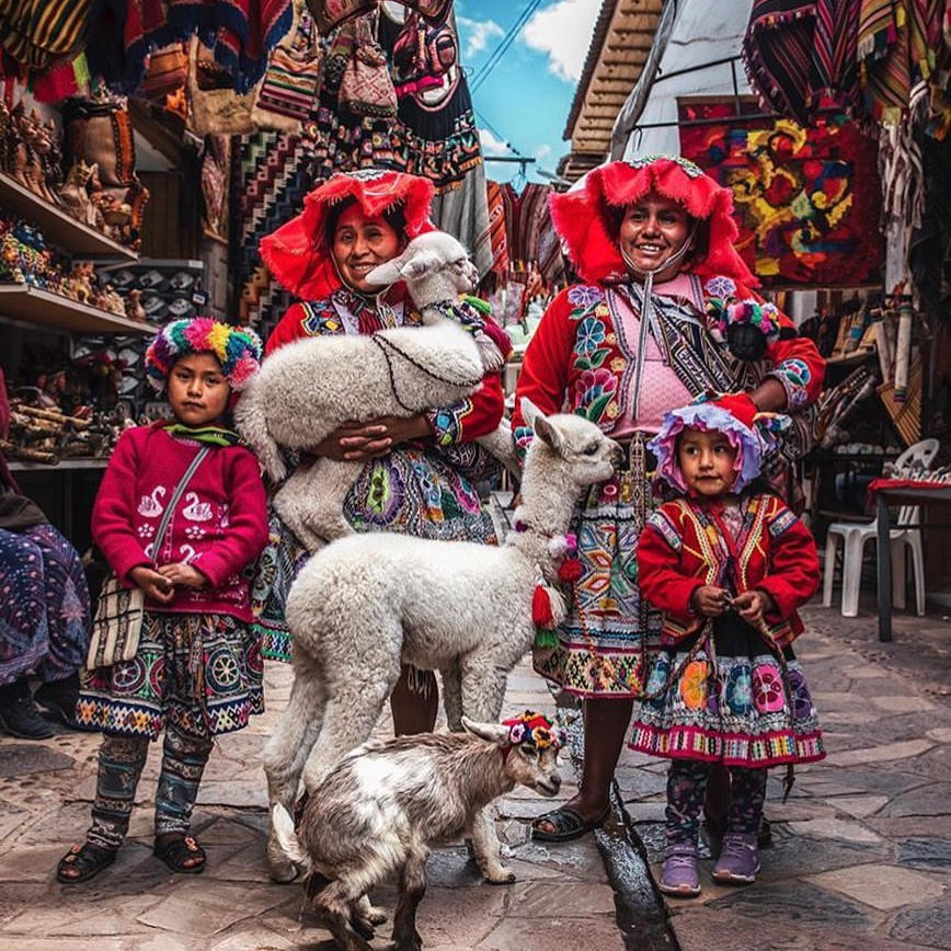 People dressed in traditional at Pisac Market near Hotel Sumaq