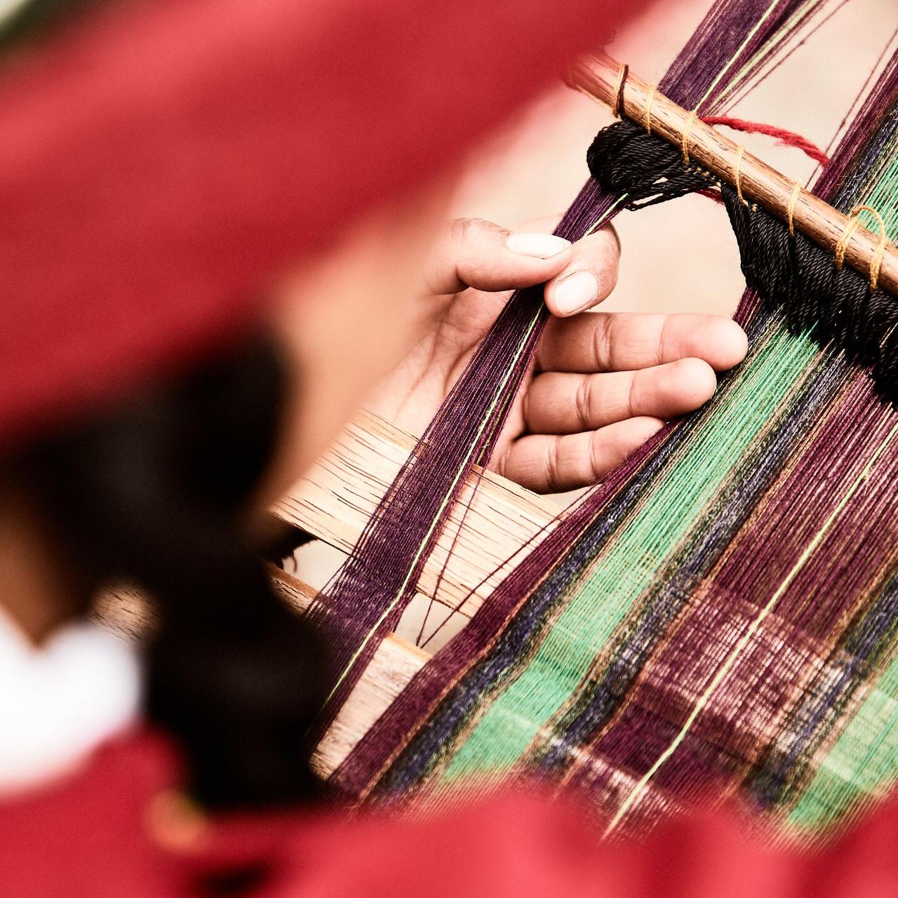 A person weaving in Chinchero near Hotel Sumaq