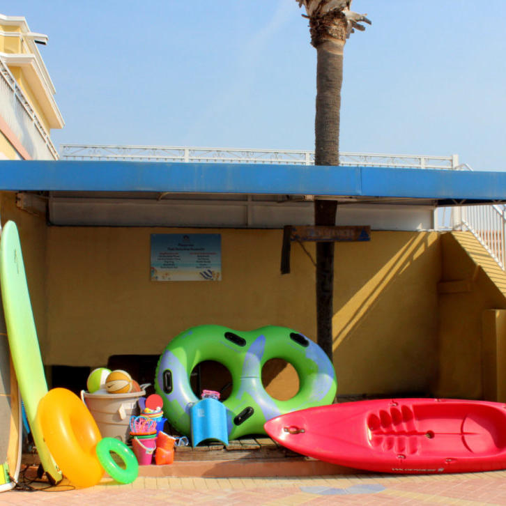 beach toys, surf boards and kayak