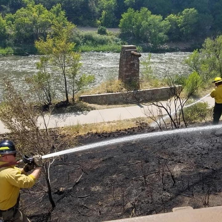 Firefighters at work on the Grizzly Creek Fire in Glenwood Canyon.