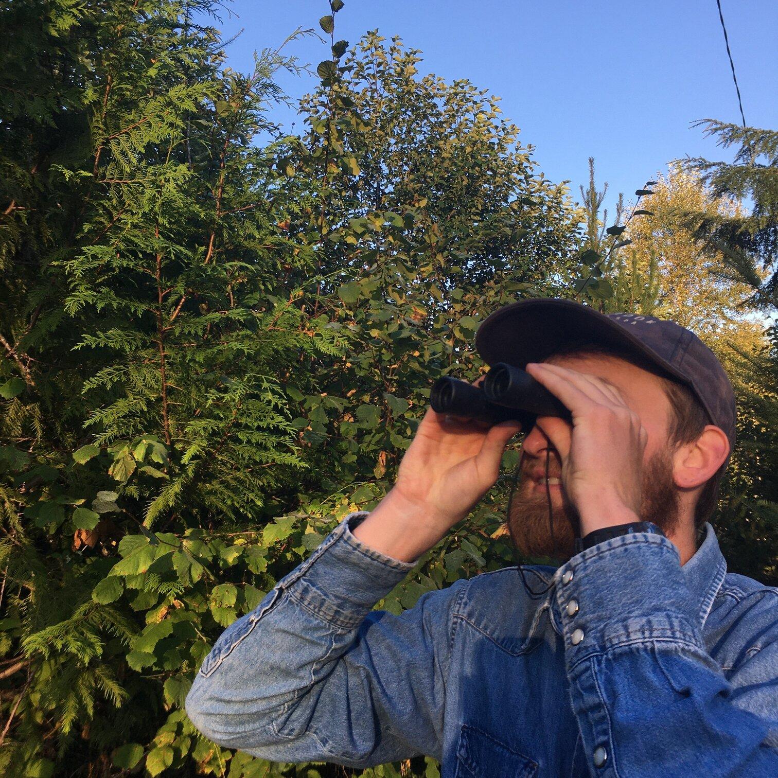 Birdwatching man at Alderbrook Resort
