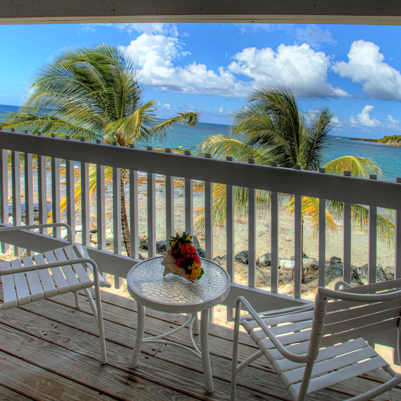 Room balcony with the view of  beach at Tamarind Reef Resort