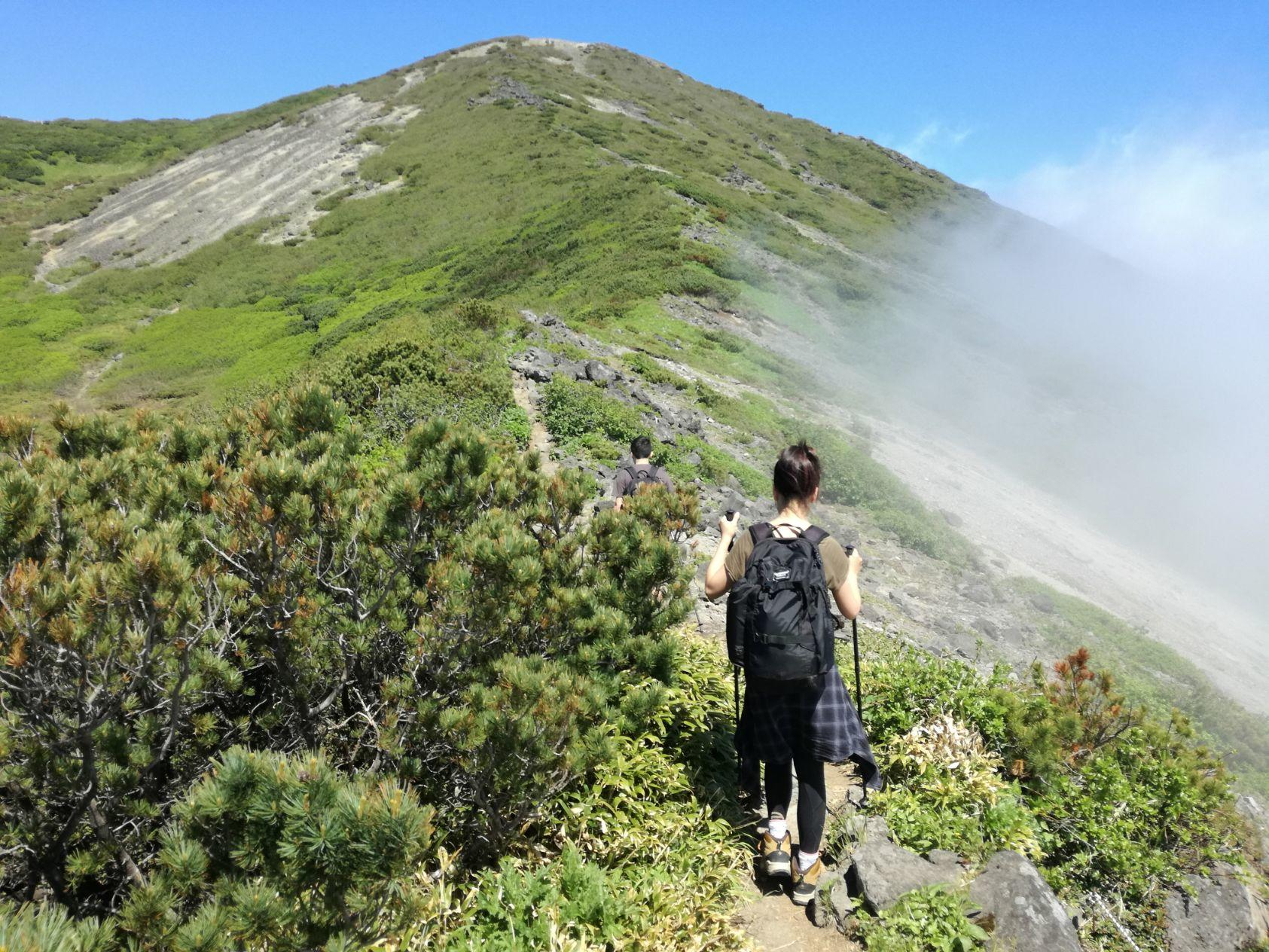 A view of a man hiking near Chatrium Niseko Japan