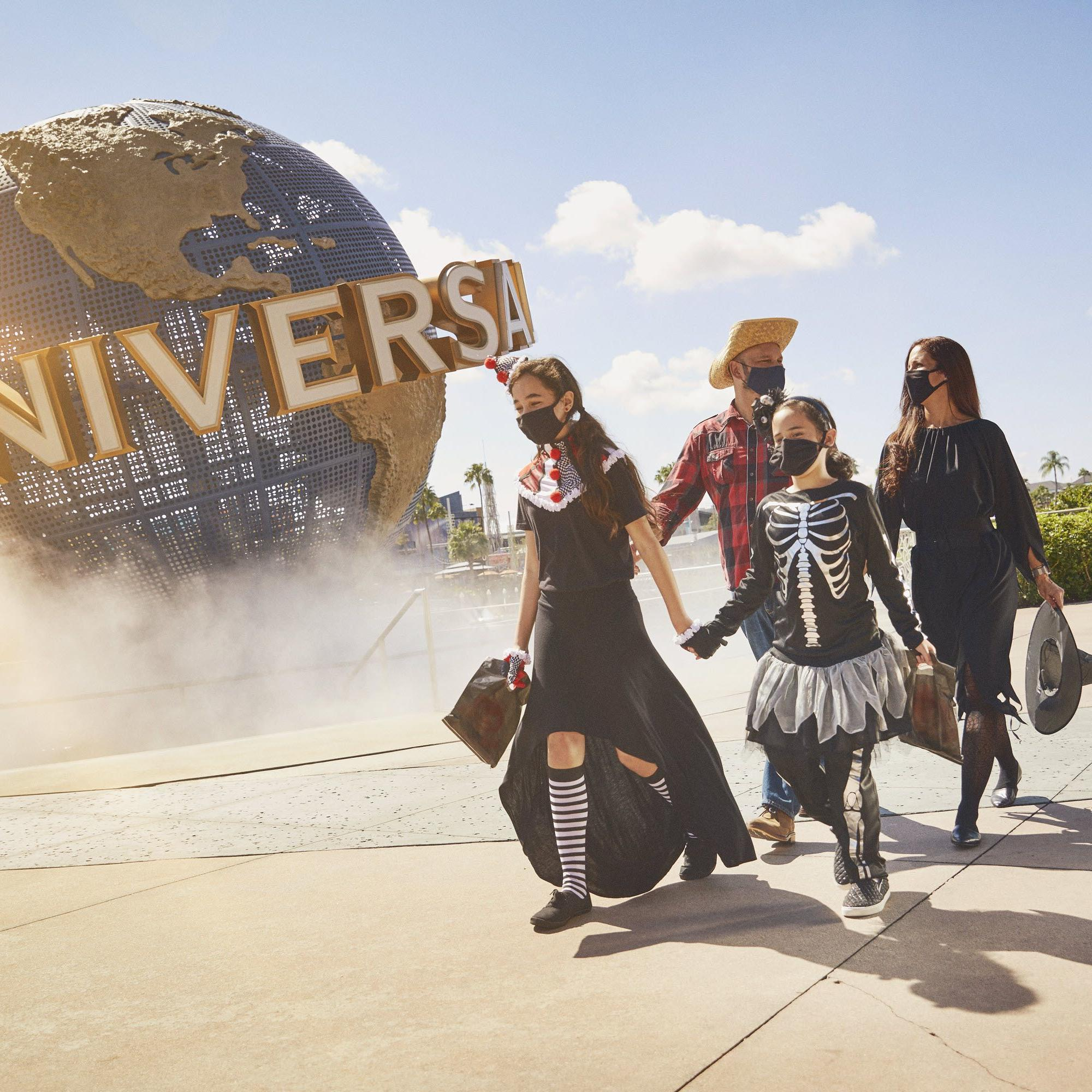 family in front of universal studios park entrance