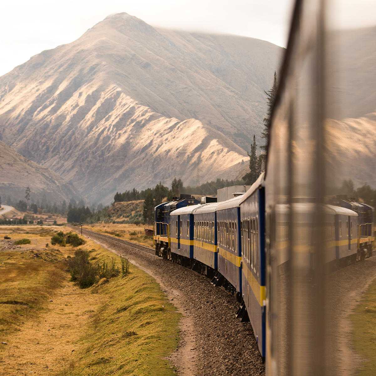 View of the train and mountains on the way to Machu Picchu