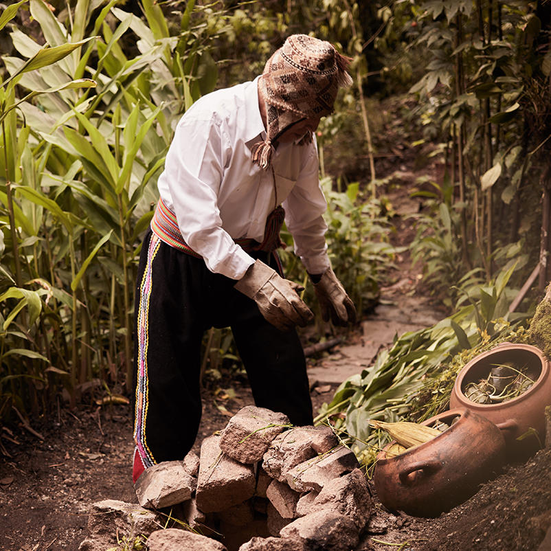 A farmer offering to Pachamanca near Hotel Sumaq