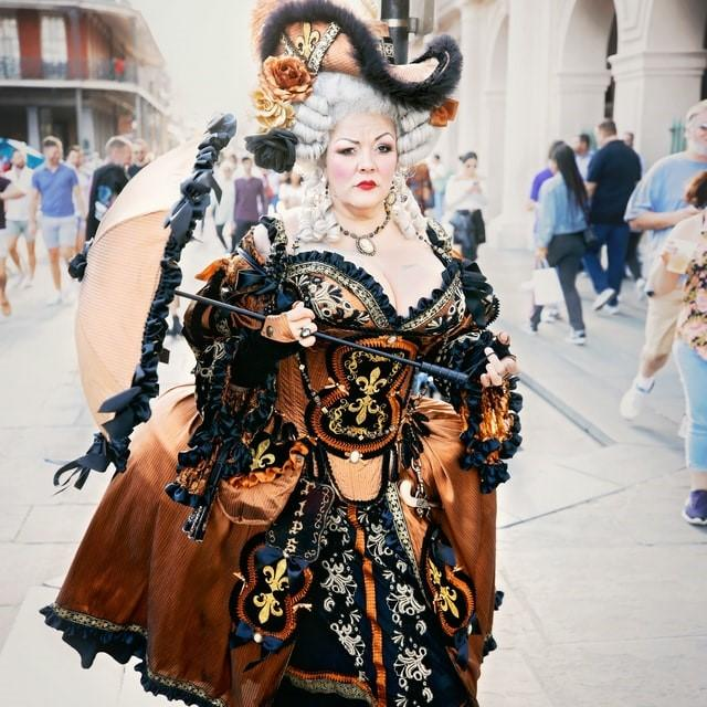 A woman dressed in a Halloween costumes in the streets