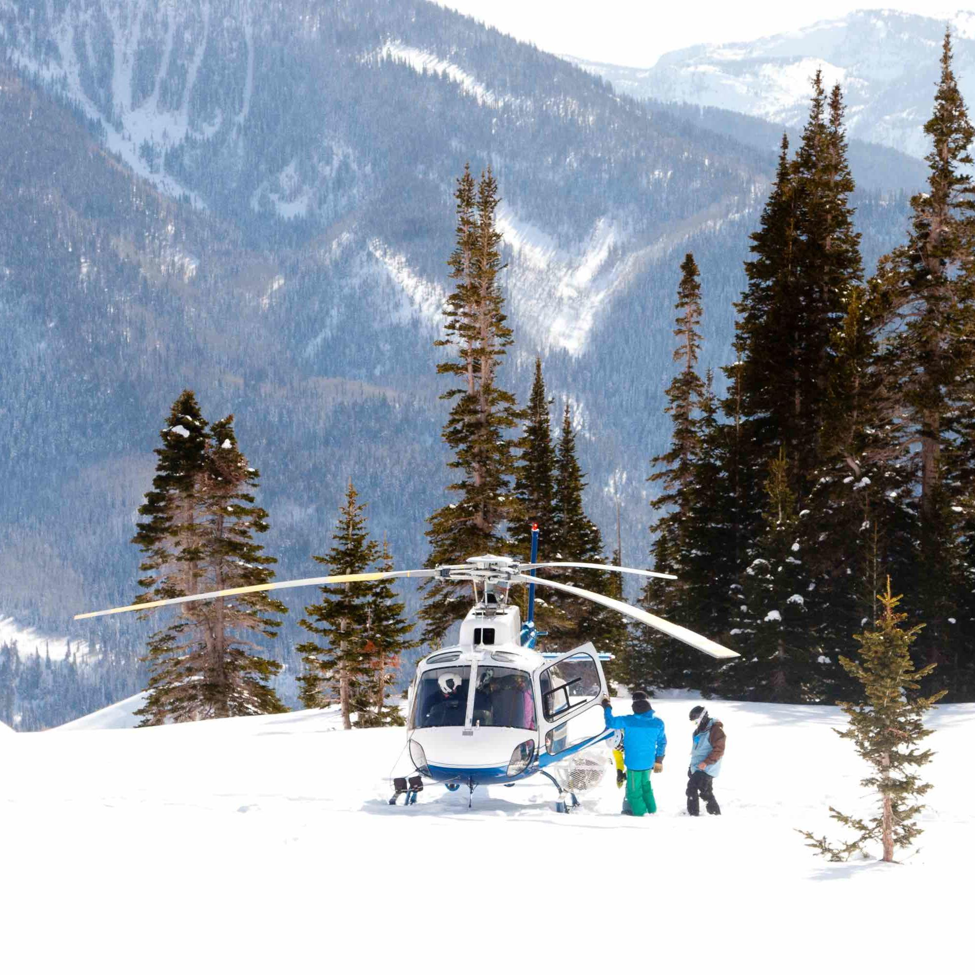 a helicopter landing in snow