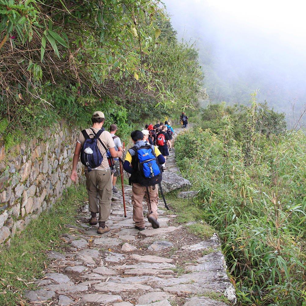 Tourists in the Inca Trail to Machu Picchu near Hotel Sumaq