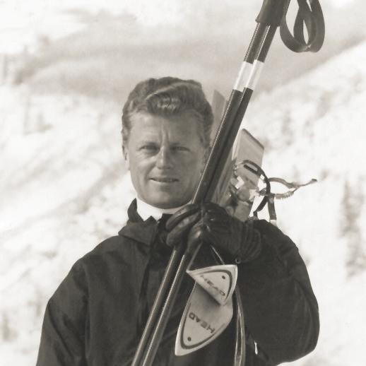 a man holding snow skis