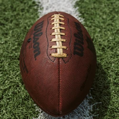 A closeup picture of a football on a field