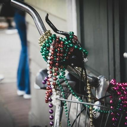 A bicycle decorated in colorful beaded necklaces in the streets