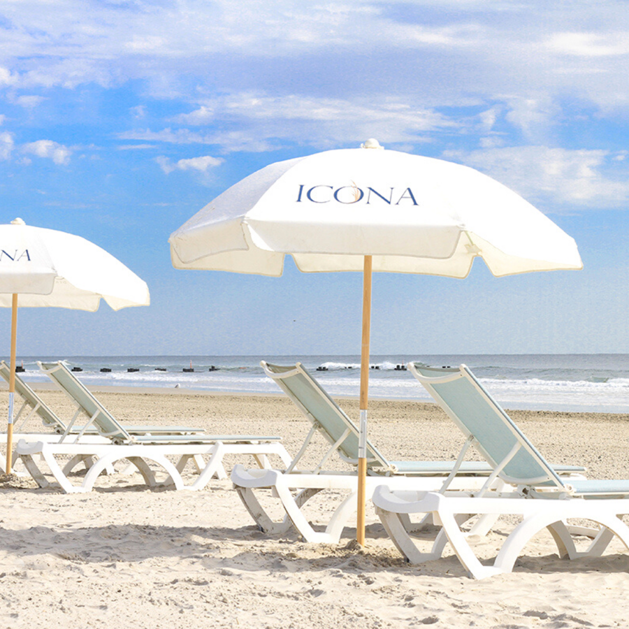 ICONA Diamond Beach Resort Chairs & Umbrellas set up on private white sand beach in southern NJ