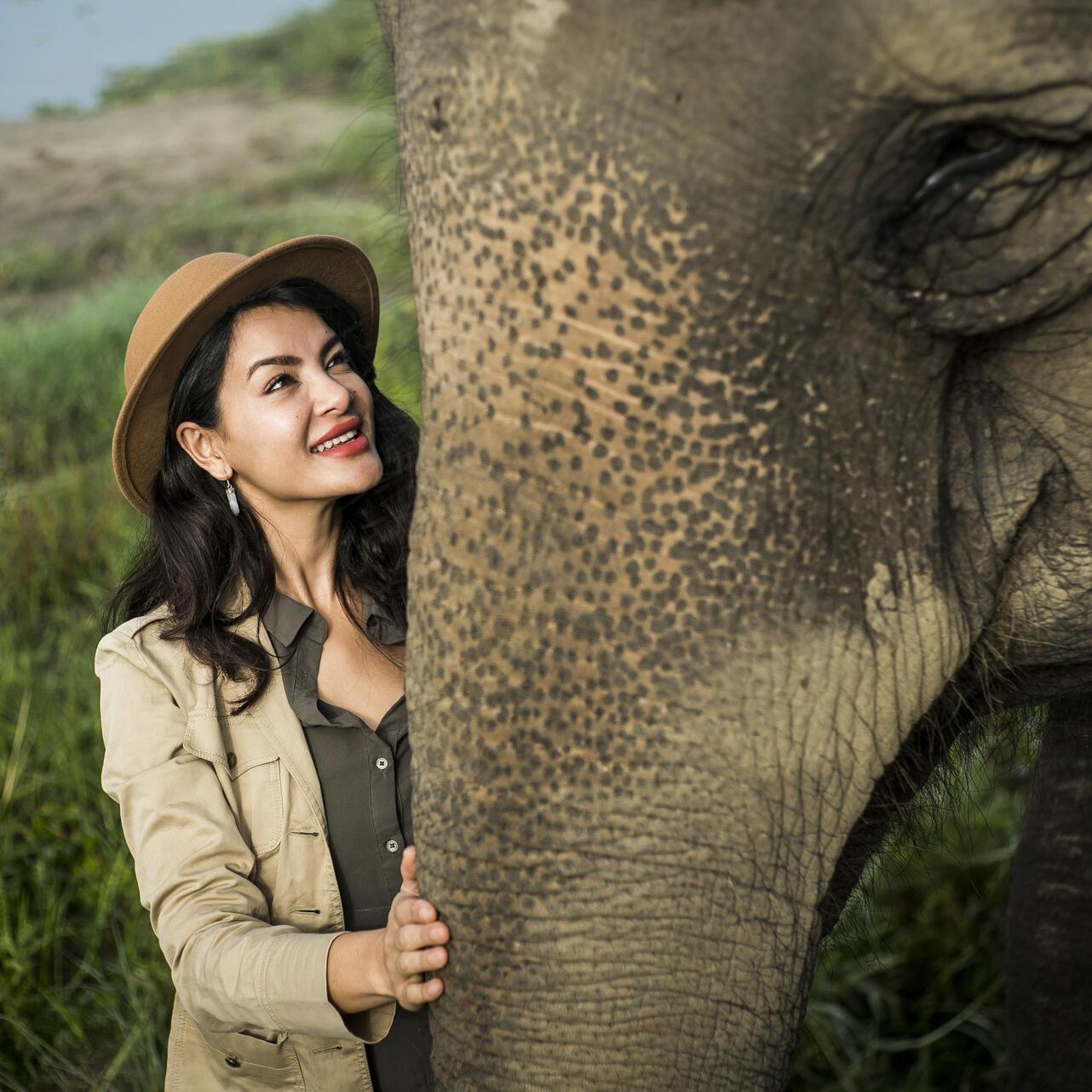 Women touching elephant at forest near Meghauli Serai