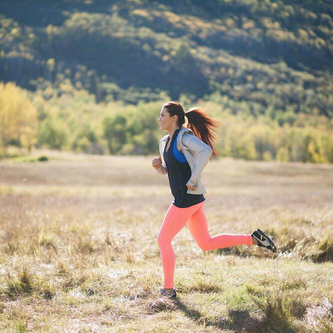 Female trail runner in spring