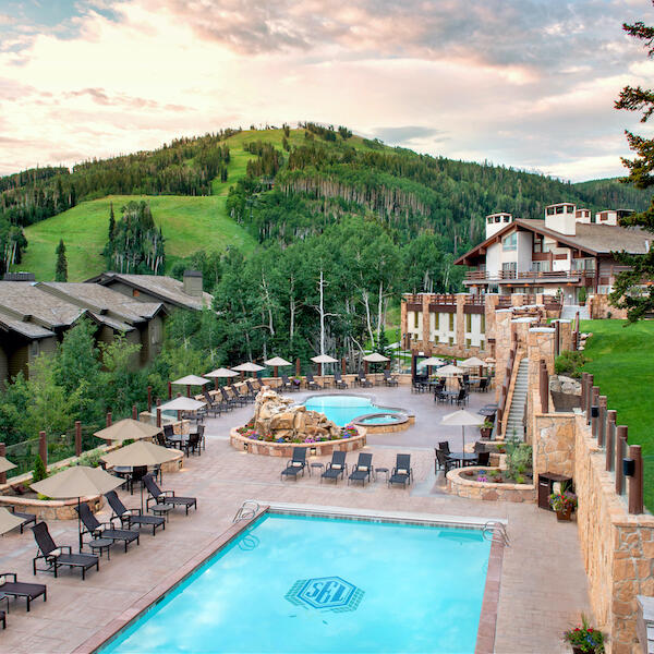 Pool overlooking mountains in summer