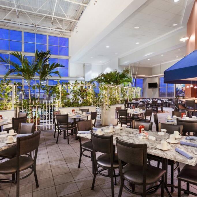 Table arranged for dinning at Inn & Suites Ocean restaurant