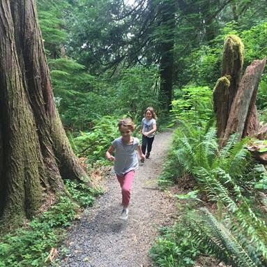 Two kids are running on the trails at Alderbrook Woods