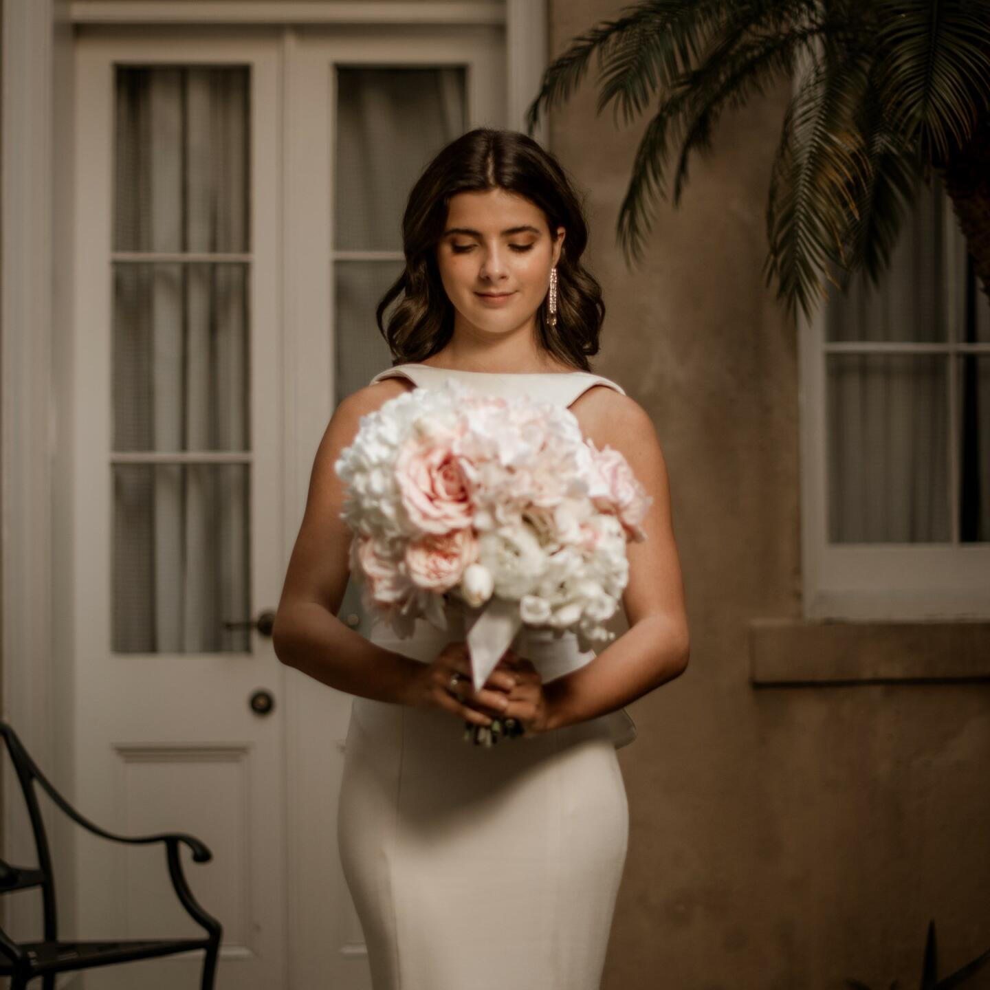 A bride posing for a photo at St. James Hotel