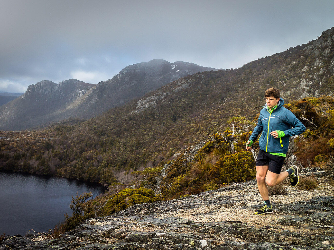 Man running at the mountains near Cradle Mountain Hotel