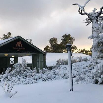 Exterior view with snow around the Cradle Mountain Hotel