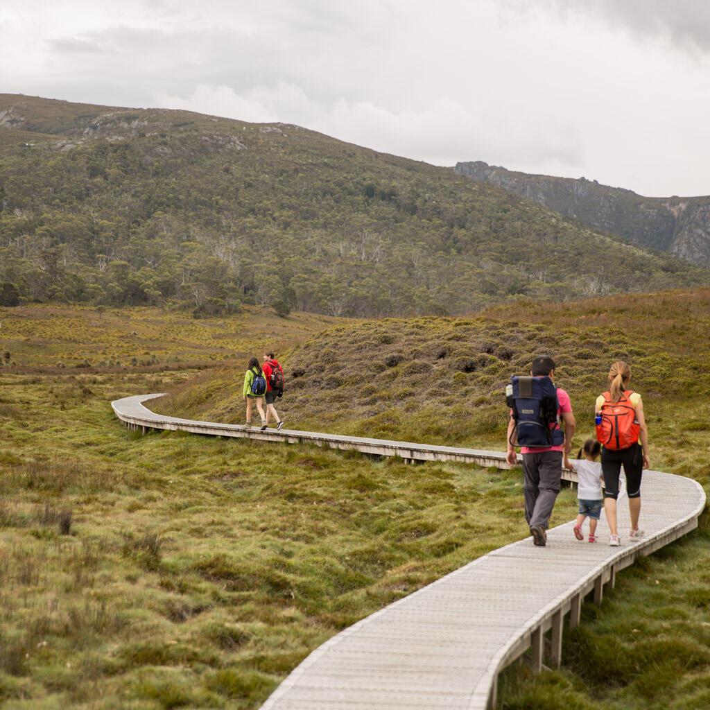 family walking towards the mountain at Cradle Mountain Hotel