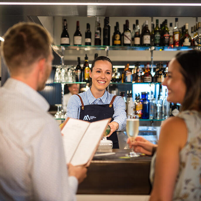 Couple at the cashier in Altitude Bar in Cradle Mountain Hotel