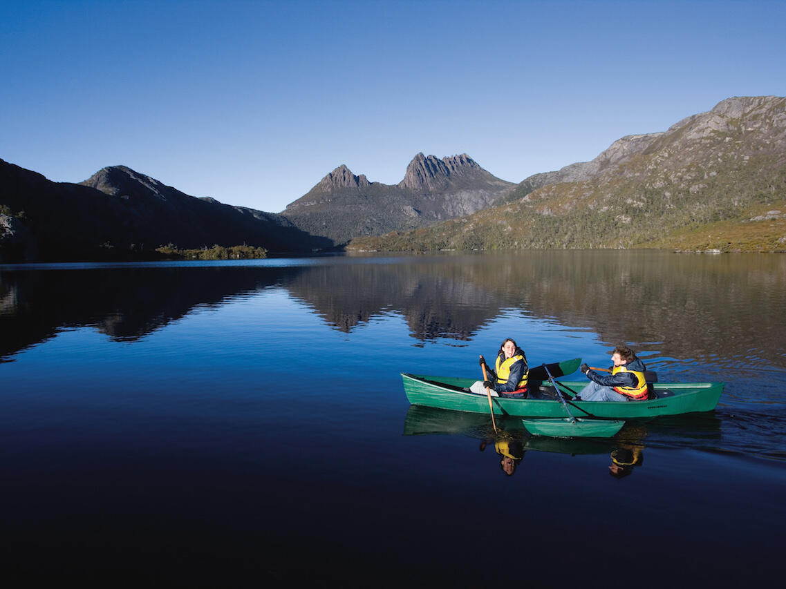 Couple on a Canoe boat at dove lake in Cradle Mountain Hotel