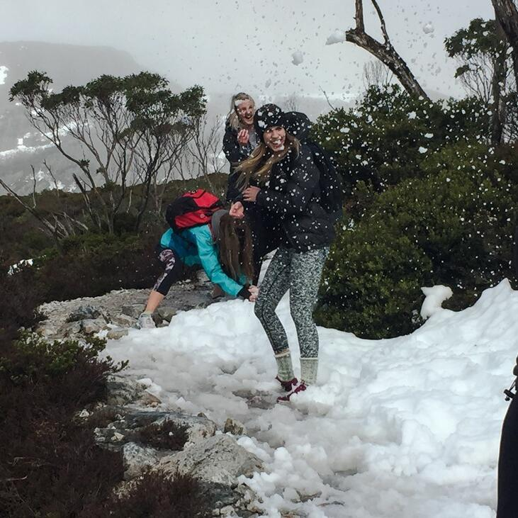 People playing with snow Cradle Mountain Hotel