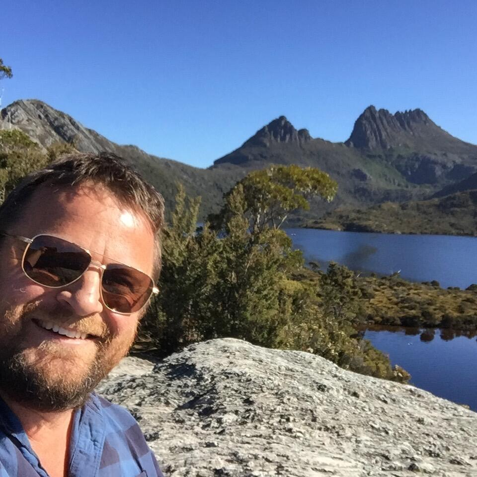 selfie photo of a man at dove lake in Cradle Mountain Hotel
