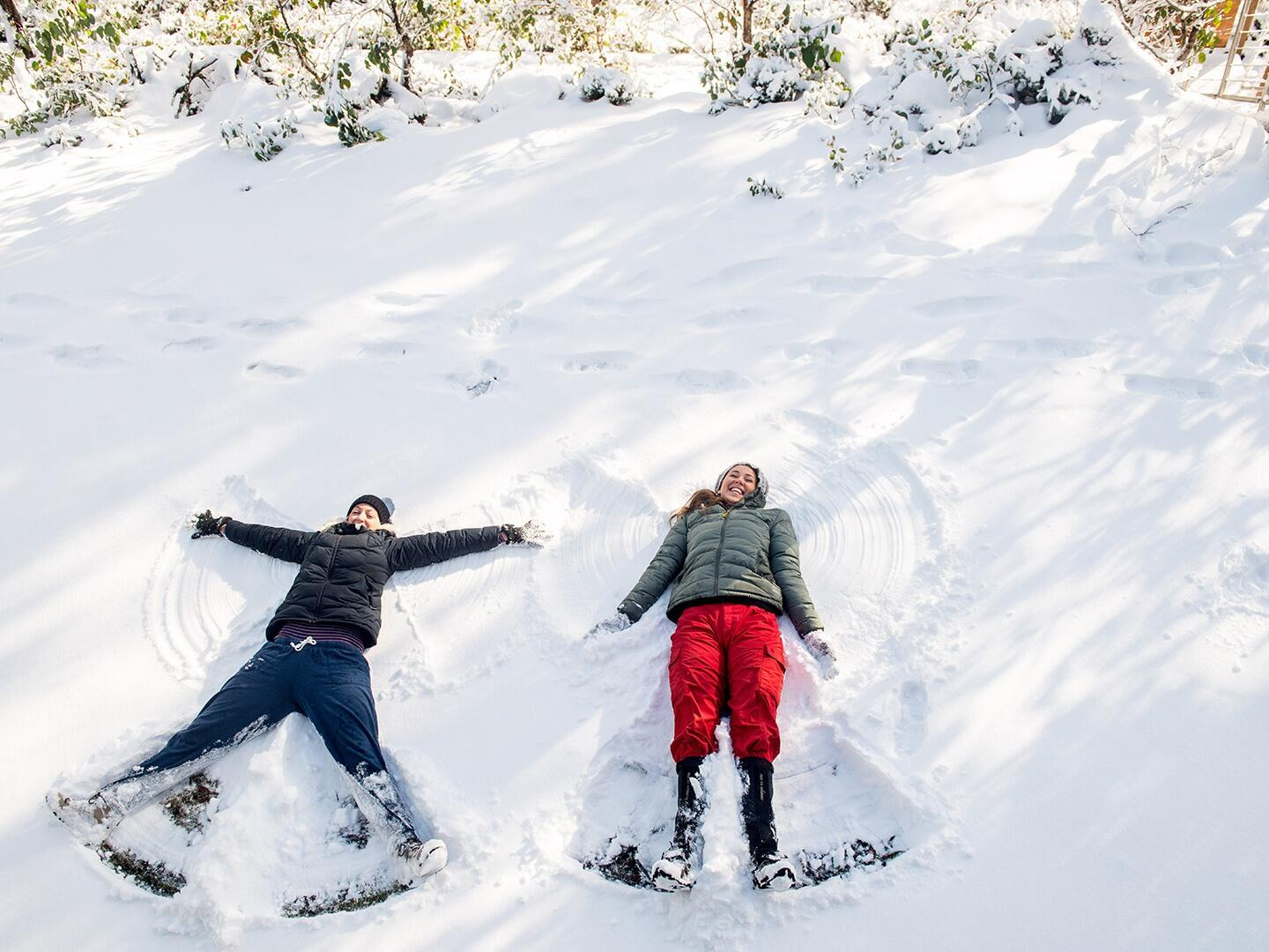 Two child having fun on snow at Cradle Mountain Hotel
