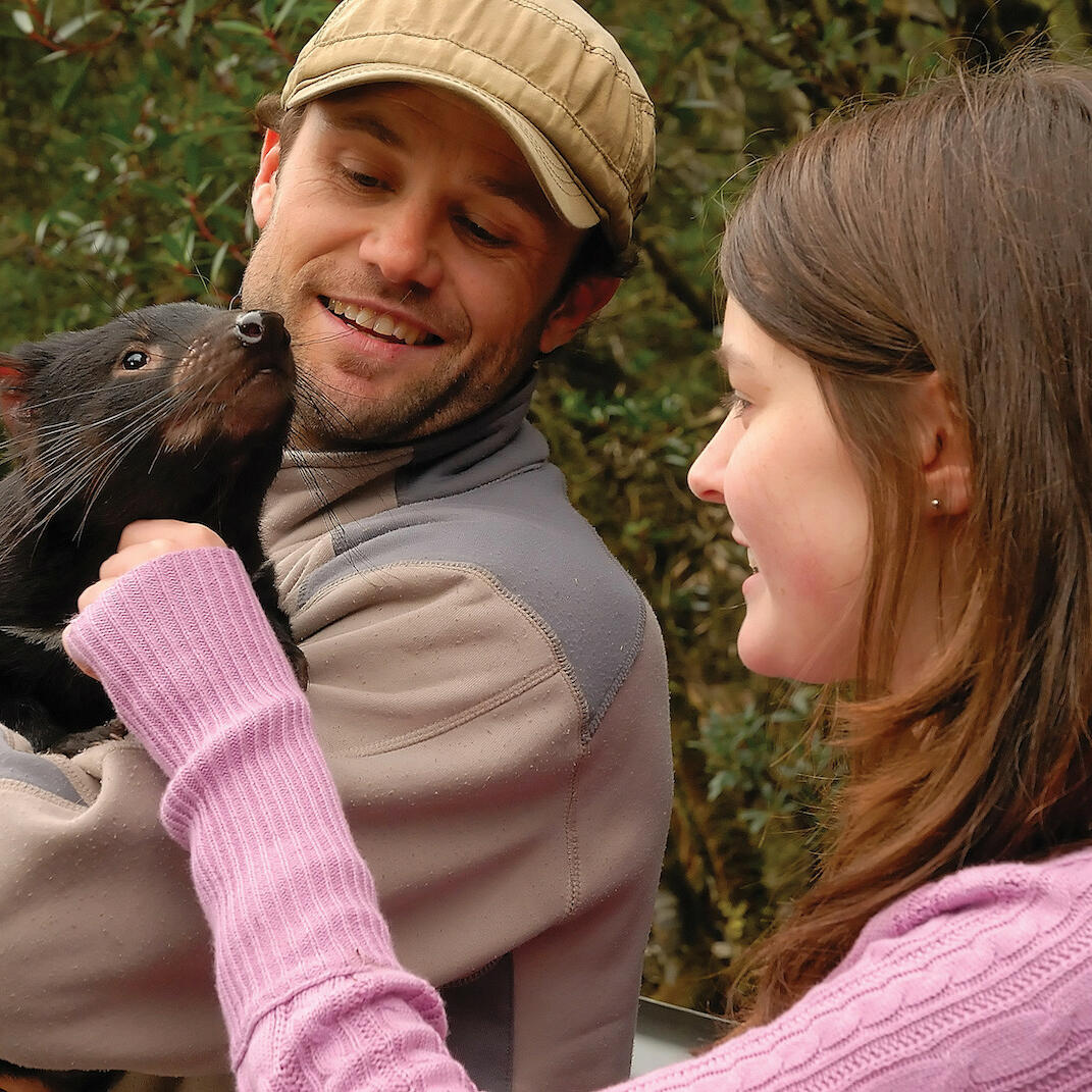couple with Tasmanian Devil at near Cradle Mountain Hotel