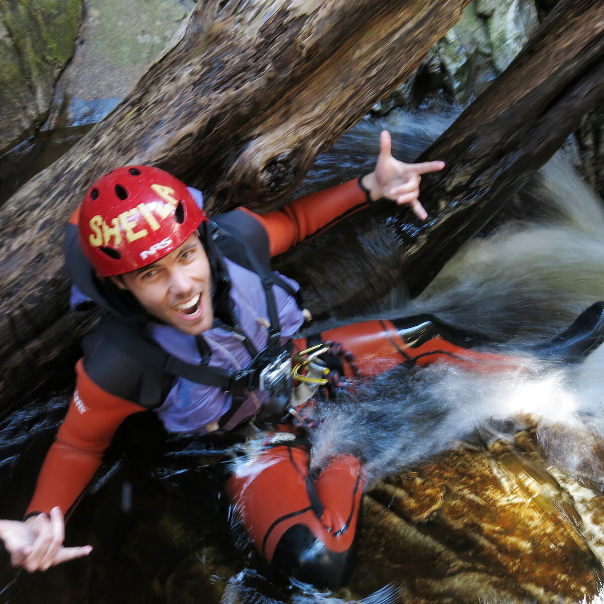 man on adventure activities in water at Cradle Mountain hotel
