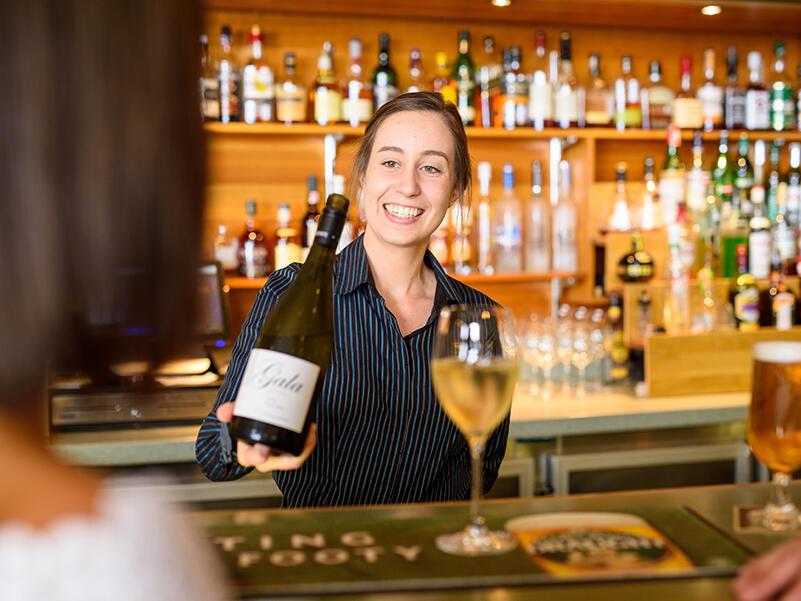 bartender serving wine at East Coast Wine in Freycinet Lodge