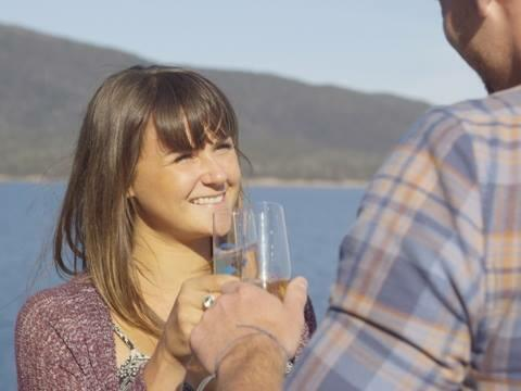 Couple having champagne at the Bay in Freycinet Lodge