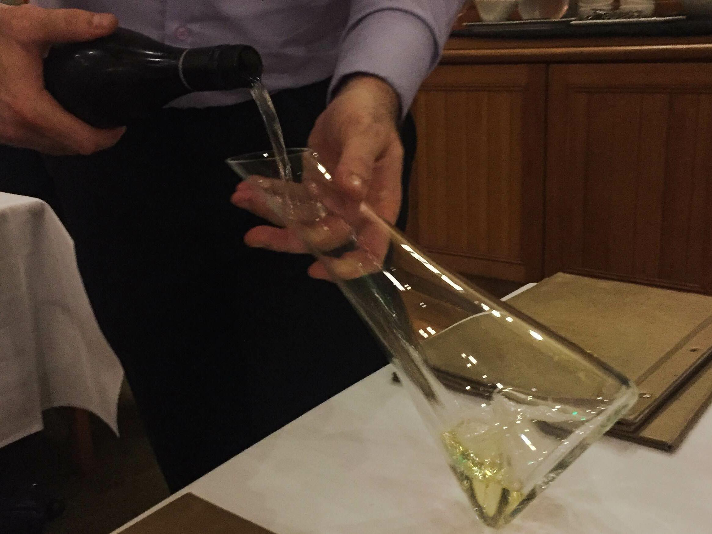 Man pouring champagne into a vessel at the Freycinet Lodge
