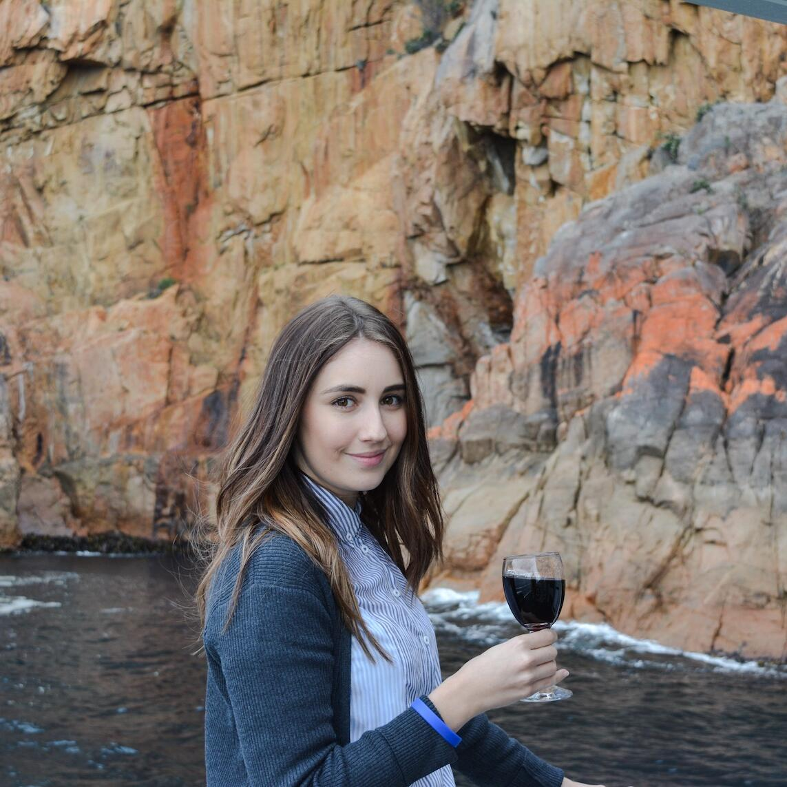 Lady with a wine glass near the Bay at Freycinet Lodge