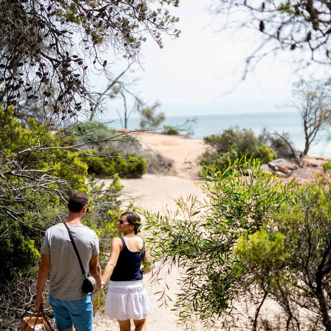 Couple on a walk near the beach at Freycinet Lodge