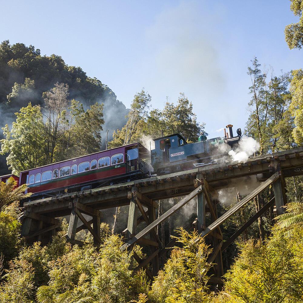 Train running on a bridge near the Strahan Village