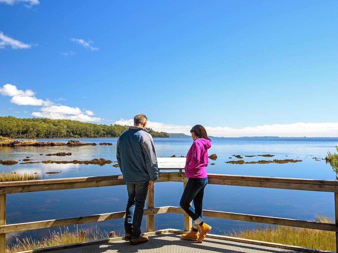 Couple at Macquarie Harbor near the river at Strahan Village