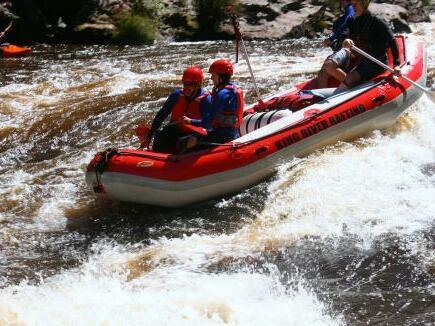 People at water rafting at king River near the Strahan Village