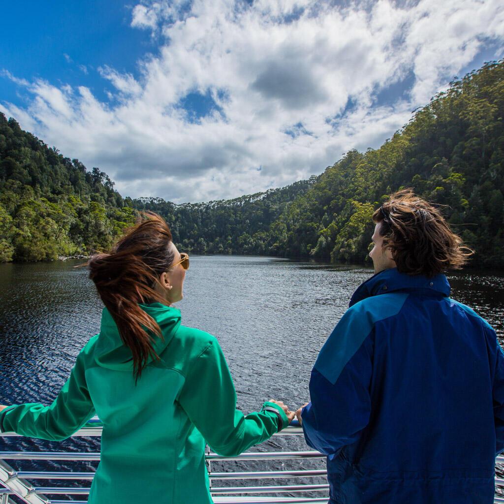 Couple near the ship in Gordon River at Gordon River Cruises