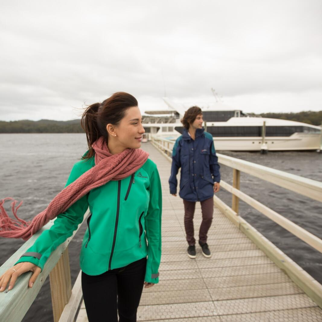 Two people at the jetty near the Gordon River Cruises