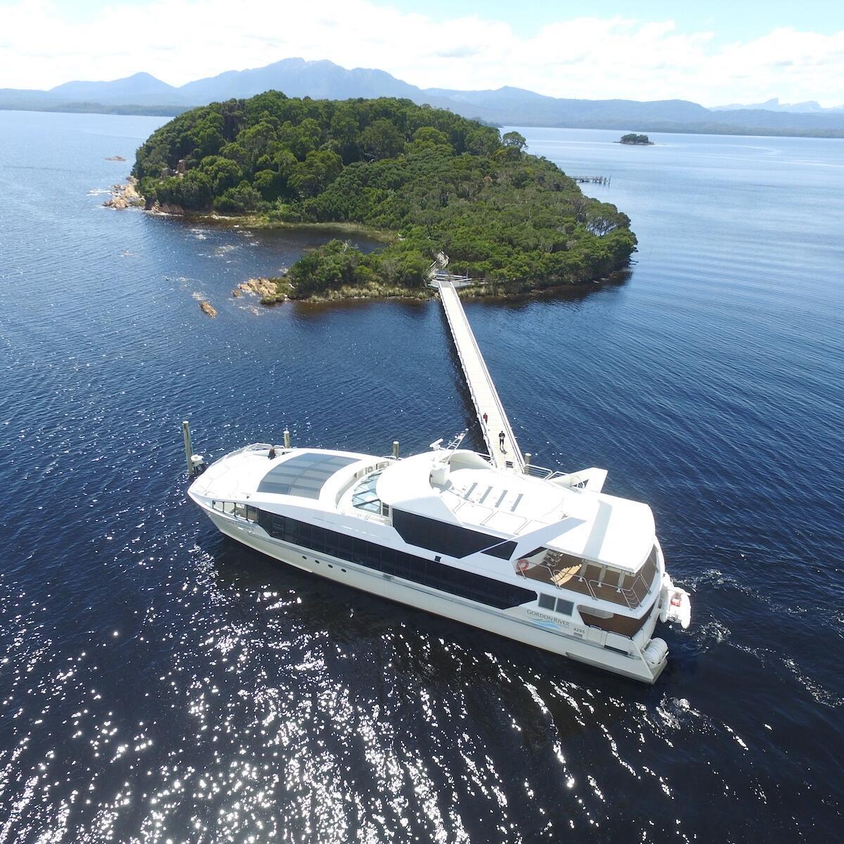 Sarah Island with the vessel ship near Gordon River Cruises