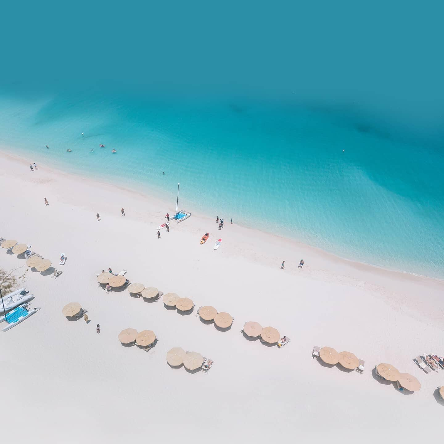 Sky view of the beach & seating area near Somerset On Grace Bay